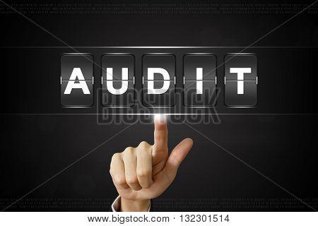 business hand pushing audit on Flipboard Display