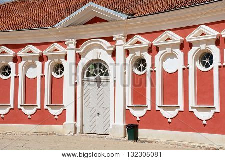 PILSRUNDALE LATVIA - JULY 27 2015: Exterior of the red painted stables building windows next to Rundale palace in Pilsrundale Latvia.