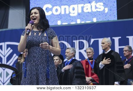 FLAGSTAFF, ARIZONA, MAY 13. Northern Arizona University on May 13, 2016, in Flagstaff, Arizona. A singer performs the National Anthem at the Northern Arizona University Commencement 2016.