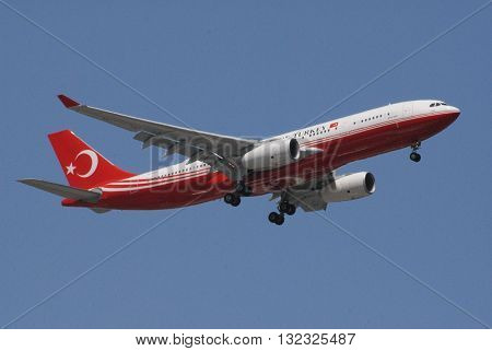 IZMIR/TURKEY-MAY 31, 2016: Turkish President Recep Tayyip Erdogan's Airbus A330-200 Prestige official aircraft over the Gaziemir skies during the approach to Adnan Menderes International Airport. May 31, 2016-Izmir/Turkey