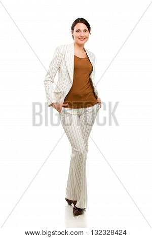 Full length portrait of a happy business woman standing isolated over white background