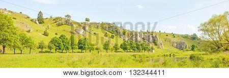 Panorama of valley Eselsburger Tal near river Brenz - jewel of the swabian alps (Schwaebische Alb) green meadow / grassland in front