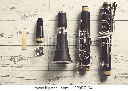 overhead of a disassembled clarinet on wood top