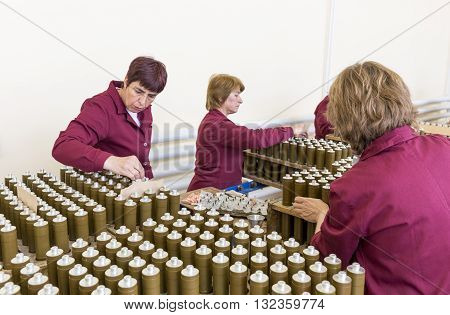Workers Checking Rpg Explosives In Munition Factory