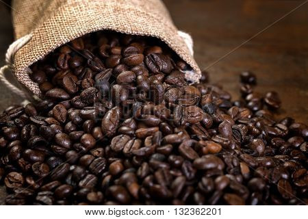 Coffee Seeds With Some Jute Bags Filled With Coffee Beans.