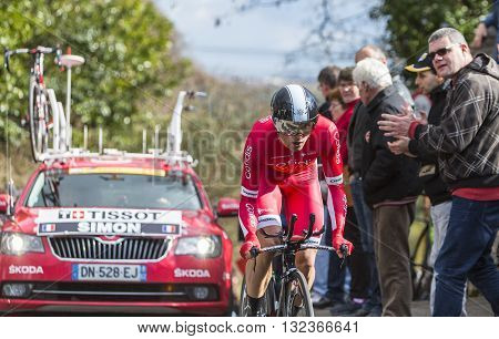 Conflans-Sainte-Honorine France-March 62016: The French cyclist Julien Simon of Cofidis Team riding during the prologue stage of Paris-Nice 2016.