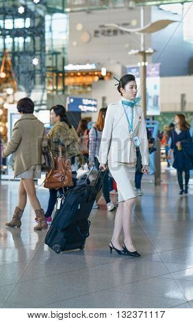 Asian Female Air Flight Stewardess In The Incheon International Airport