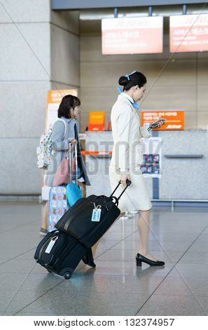 Asian Air Flight Hostess At Incheon International Airport