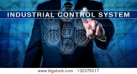 Manager is pushing INDUSTRIAL CONTROL SYSTEM on an interactive virtual touch screen. Industry metaphor and business and computing concept for embedded control of industrial processes.