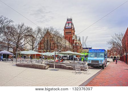 Memorial Hall And Tourists In Harvard University In Cambridge