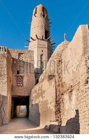 Ancient minaret of Ayyubid Mosque in the village of Al Qasr Dakhla Oasis Egypt.