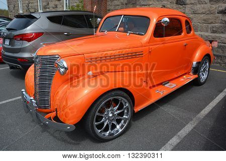 BROMONT QUEBEC CANADA 05 23 16: Hot rods are old classic American cars with large engines modified for linear speed. A possible origin includes replacement of the camshaft with a new