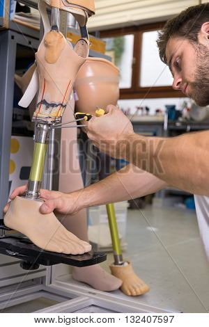 Close Up Of Man Adjusting False Limb