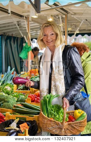 Friendly Woman Shopping For Fresh Vegetables