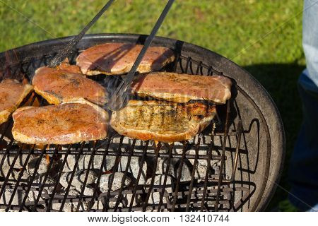 Barbecue Grill Steaks Grilled meat on the Flamed BBQ.