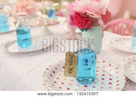 The 'Drink Me' potion Alice in wonderland tea party themetoning
