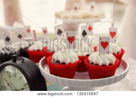 Red velvet cupcakes with cards toppers Alice in wonderland tea party toning