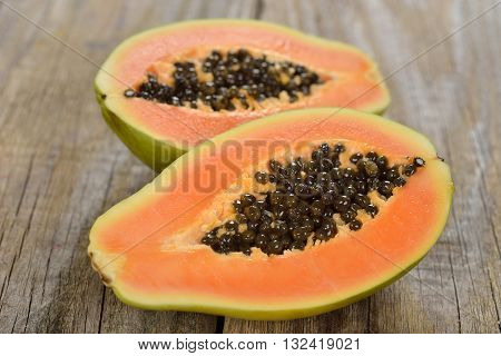 Fresh papaya on a wooden background close up