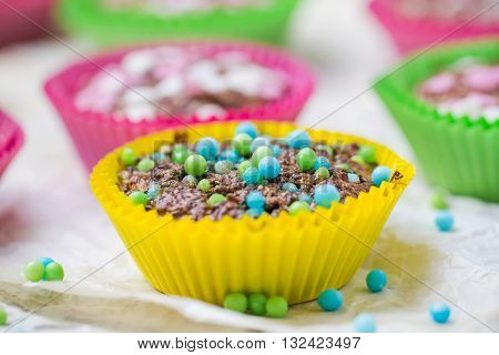 Colourful vertigo: sweet muffins in different colors