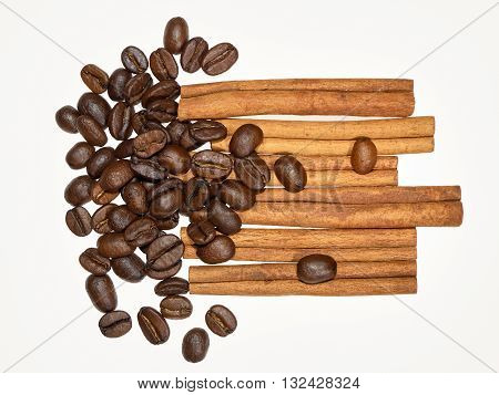 Coffee beans and cinnamon sticks on white background