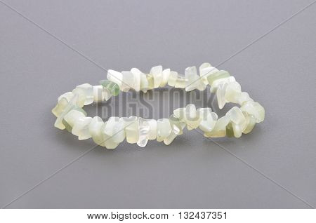 Splintered Jade Chain On Gray Background