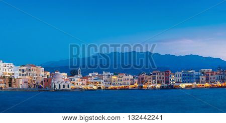 Panoramic view of Venetian quay of Chania with Kucuk Hasan Pasha Mosque during twilight blue hour, Crete, Greece poster