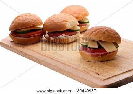 Homemade sandwiches with gourmet and tomate on the cutting board