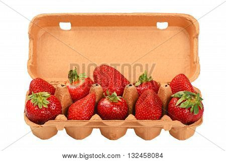 Strawberry In Open Brown Egg Carrier Over White
