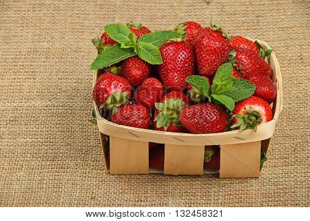 Strawberry And Mint Leaves In Basket On Canvas