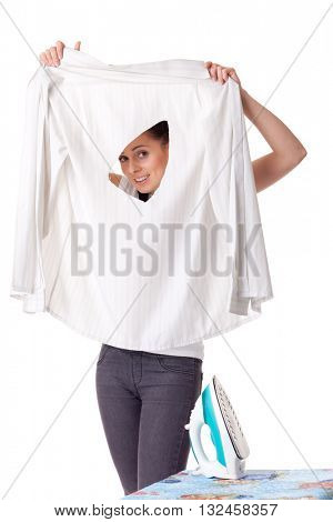 Young woman with shirt and iron on a white background. Housekeeping.