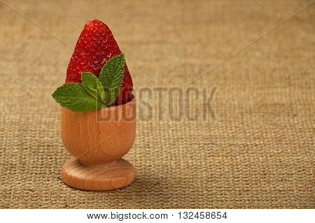 Strawberry And Mint Leaves In Eggcup On Canvas