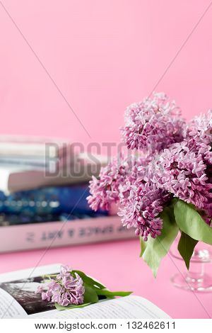 pink background with lilac flowers. abd books. greeting card. vertical. place for text