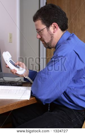 Middle-Aged Man Dialing A Phone