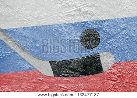 Hockey puck hockey stick and the image of the Russian flag on the ice