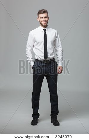 Portrait Of Handsome Young Businessman On White Background.