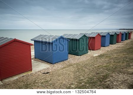 Beach huts along seafront at Hastings in Sussex