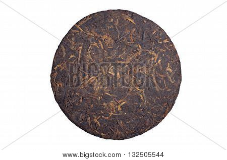 Pressed chinese pu-erh tea isolated on a white background top view
