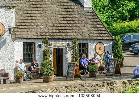 KILLIN SCOTLAND - JUNE 01 2016: Customers sitting outside of the Falls of Dochart Inn in Killin.