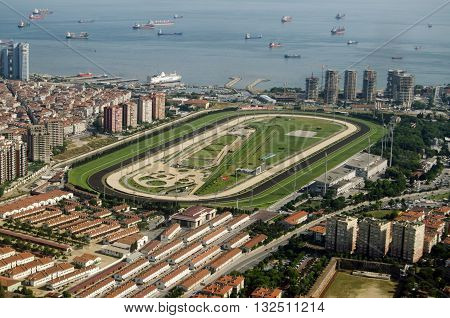 ISTANBUL TURKEY - MAY 30 2016: Aerial view of the Veliefendi Racecourse in Istanbul. In the foreground are stables and behind the Marmara Sea with many tankers waiting to travel along the Bosphorus Strait to the Black Sea.