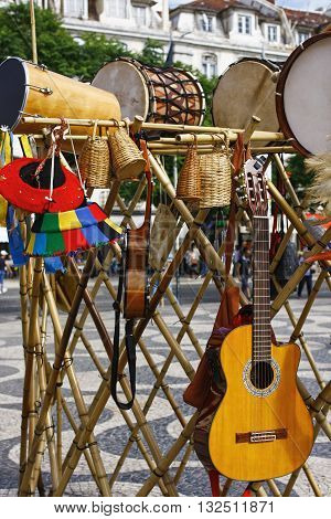 Drums acoustic Guitars and basketry in a fair shop