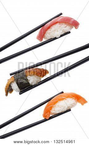 Sushi Nigiri Set In Chopsticks Isolated On White Background