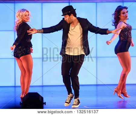 NEW YORK-JAN 12: Witney Carson (L) and Mark Ballas perform at Dancing with the Stars: Live! Tour at the Beacon Theatre on January 15, 2015 in New York City.
