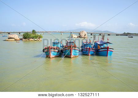 Four fishing schooners anchored at the mouth of the Cai river. Nha Trang, Vietnam