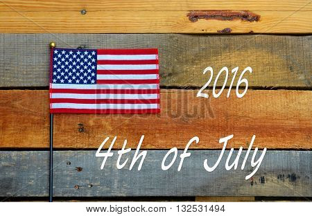 4th of July 2016, Flags set on pallet wood.  American USA National Holiday.