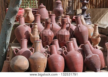 Ancient old dusty pottery Roman amphoras vases