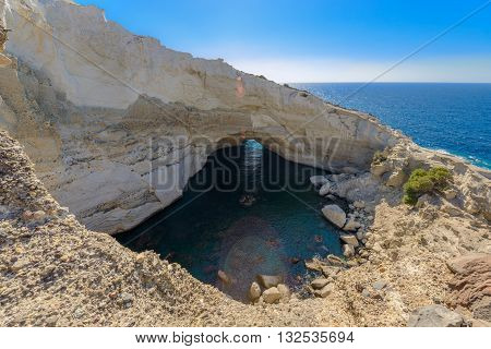 Sykia Beach or Sykia Cave was a sea cave the roof of which collapsed creating a sink hole. It is located on the west coast of Melos Island in Greece and is accessible only by sea.