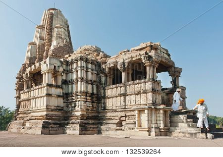 KHAJURAHO, INDIA - DECEMBER 24, 2015: Elderly men in turbans descend from the white stone Hindu temple on December 24, 2015. UNESCO World Heritage Site Khajuraho Group of Monuments built between 950 - 1150