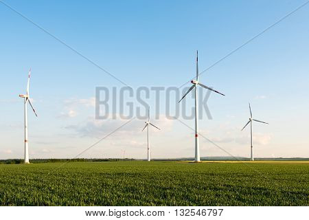 Wind turbines in front of a coal-fired plant in the Ruhr Area in Germany, a very industry intense section with large brown coal mines now setting up wind turbines to cover the enery consumption in a sustainable way