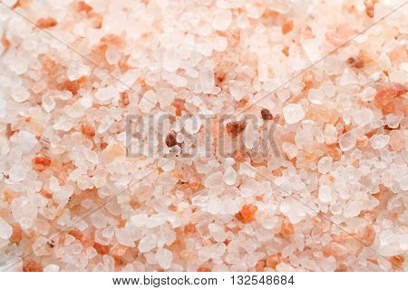 Himalaya pink salt background. Himalayan salt pile. Pink crystal salt. Close up Himalayan salt - pink and orange coarse crystals.