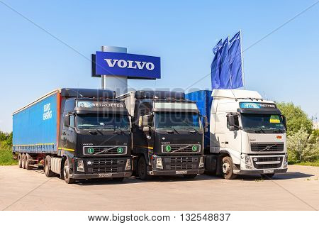 SAMARA RUSSIA - MAY 29 2016: Volvo trucks parked at the service station in summer day. Volvo is a Swedish multinational automaker company
